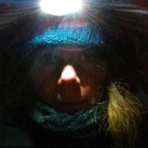winter selfie with headlamp in my tent
