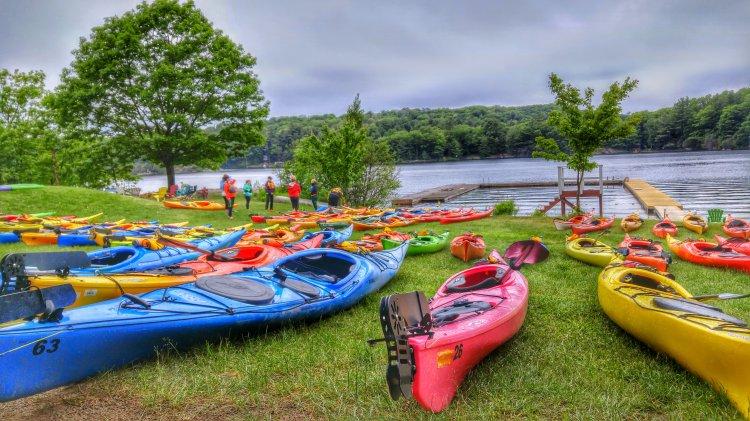 kayaks at women on water